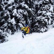 Having fun skiing on between digging